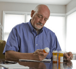 Man reviewing medications