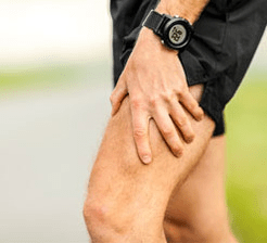 Runner with leg muscle spasm