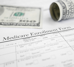 Medicare enrollment form with money