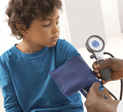 Doctor checking child%e2%80%99s blood pressure