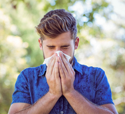 Man suffering from summer allergies