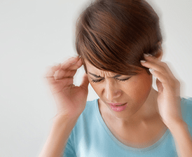 Young woman with migraine